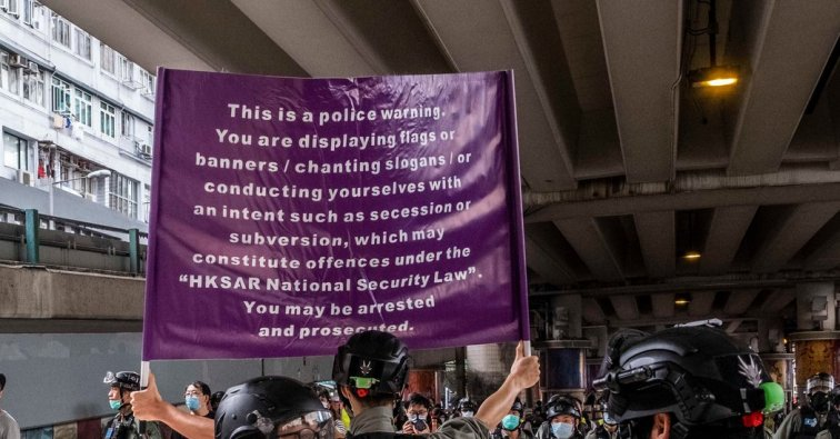 hong-kongs-new-weapon-against-protesters-a-purple-warning-flag
